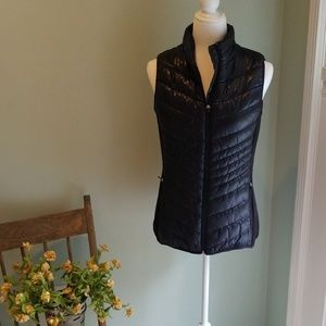 Womens black quilted vest.